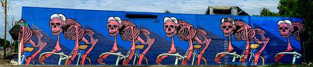 skeletons on bikes